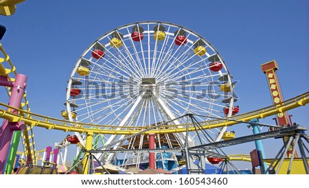 Ferris Wheel and Roller Coaster - stock photo