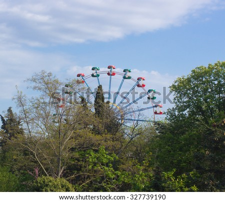 Ferris wheel at an amusement park - stock photo