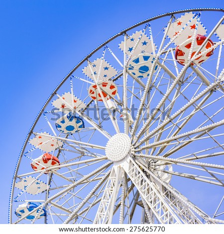 Ferris Wheel at the county fair with the sky in the background - stock photo