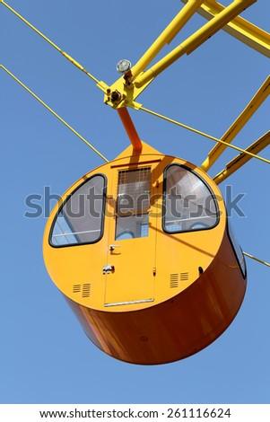 ferris wheel cabin against the blue sky  - stock photo