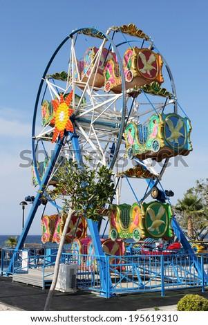 Ferris Wheel in Amusement Park - stock photo