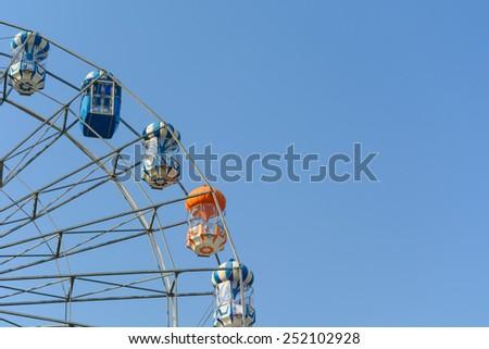 Ferris wheel in blue sky - stock photo