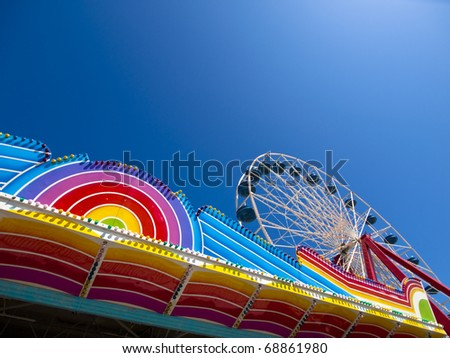 Ferris Wheel in Colorful Amusement Park with Blue sky