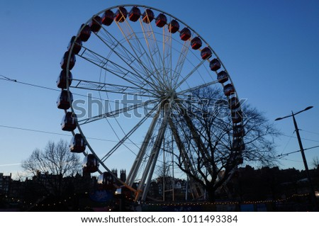 Ferris wheel in  Edinburgh with blue sky background, Scotland