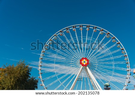 Ferris wheel in entertainment center - stock photo