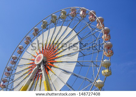 ferris wheel in funfair - stock photo