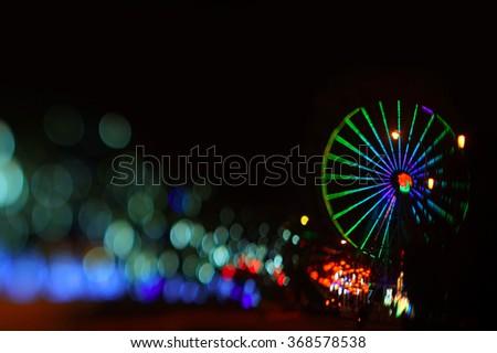 Ferris wheel in glowing background                            - stock photo