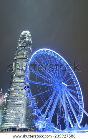 Ferris wheel in Hong Kong City at night - stock photo