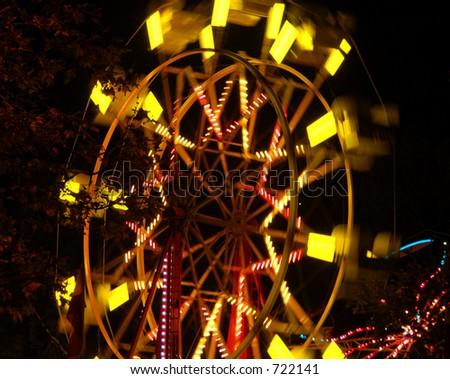 Ferris Wheel in Motion - stock photo