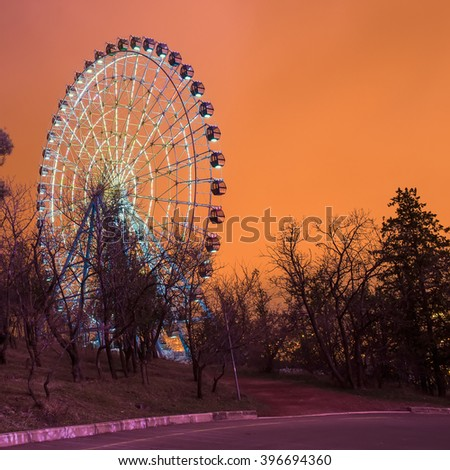 Ferris wheel in the park at night Tbilisi - stock photo