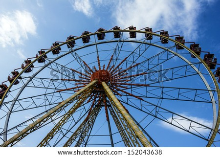 Ferris wheel in the park in evening. - stock photo