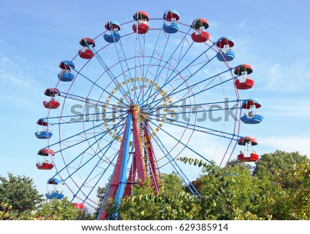 Ferris wheel in the summer morning