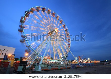 Ferris Wheel(motion) at amusement park at twilight time