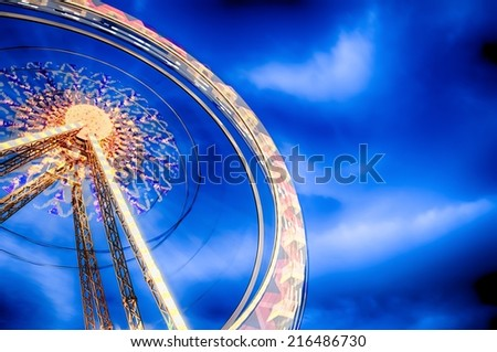 Ferris Wheel motion at nigh. HDR image. - stock photo