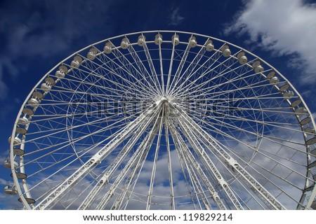 Ferris wheel on a blue sky as a background, Marseille France - stock photo