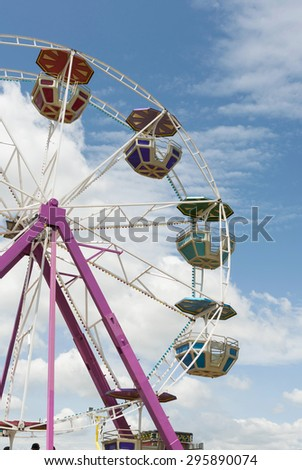ferris wheel on a summer blue sky - stock photo