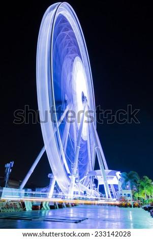 Ferris wheel on night. Long time exposure. - stock photo