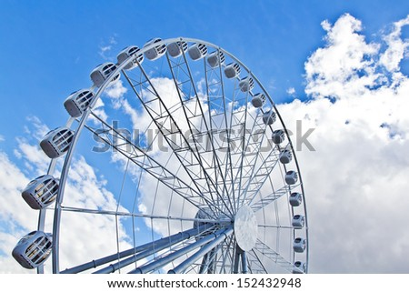 Ferris Wheel On Sky Background. High quality stock photo.