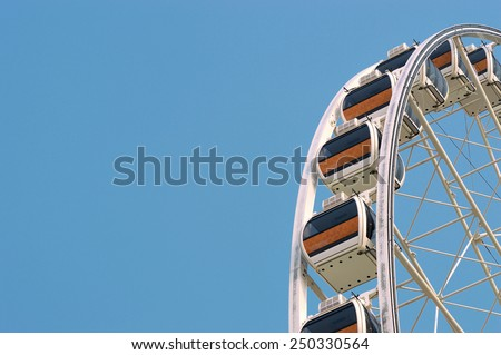 Ferris wheel on the background of blue sky. motionless - stock photo