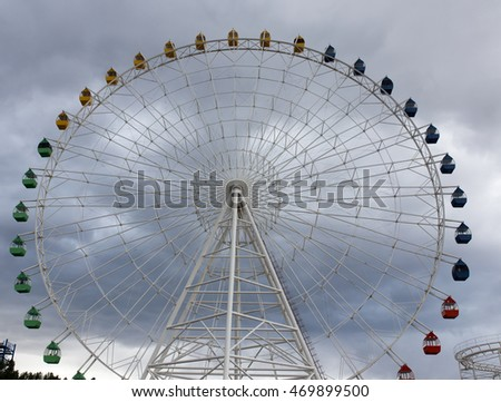 Ferris wheel on the background of clouds