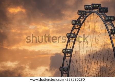 Ferris Wheel on the background of evening sky, Singapore - stock photo