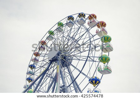 Ferris wheel on the background of sky. Toned photo. - stock photo