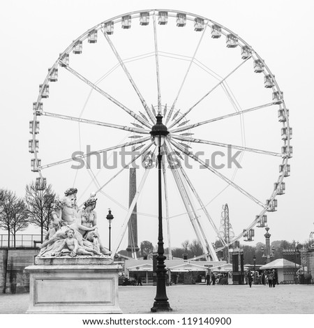 Ferris wheel on the concorde square seen from the tuilerie garden in Paris, france - stock photo