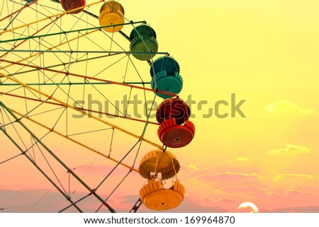Ferris wheel on the sunset background - stock photo