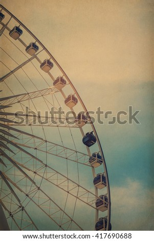 Ferris Wheel Over Blue Sky, grunge vintage style. - stock photo