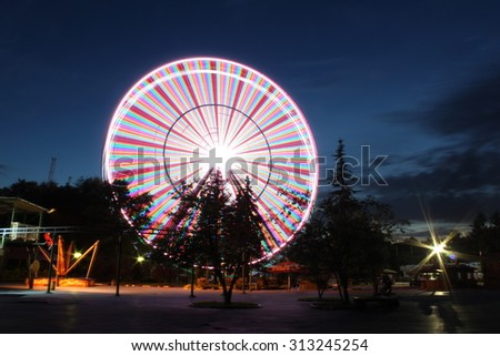 Ferris wheel over night sky