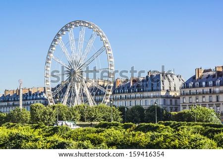 Ferris wheel (Roue de Paris) on the Place de la Concorde from Tuileries Garden. Ferris wheel was installed for 2000 millennium celebrations. Paris, France. - stock photo