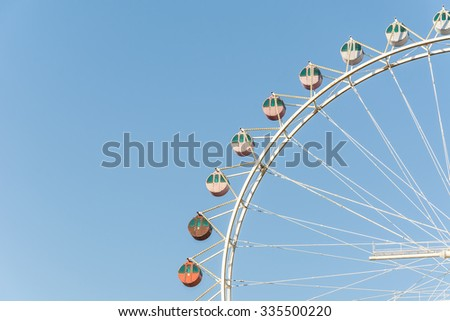 Ferris wheel with blue sky - stock photo