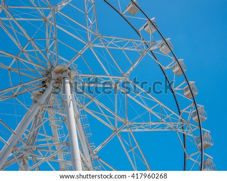 Ferris wheel with blue sky - stock photo