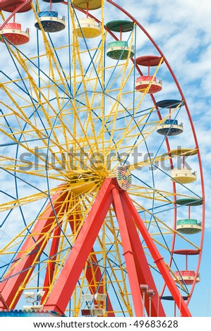 ferris wheel with blue sky in amusement park - stock photo