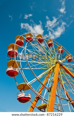 Ferris wheel with blue sky in background.Colorful ferris wheel at carnival in North Carolina - stock photo