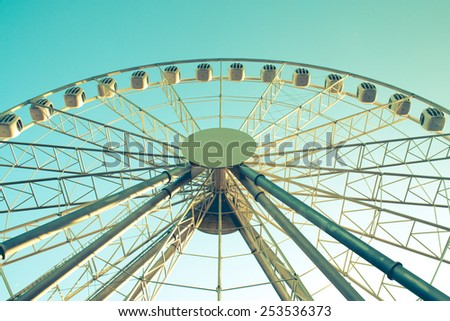 Ferris wheel with blue sky. outdoor shot