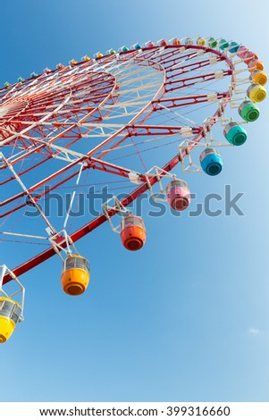 Ferris wheel with clear blue sky - stock photo