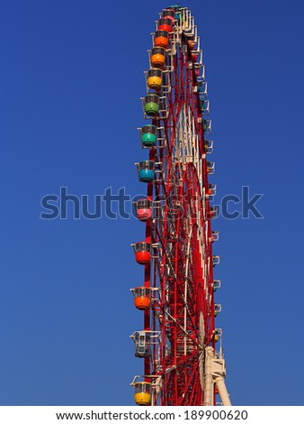 Ferris Wheel with Clear Blue Sky Background
