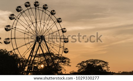 Ferris wheel with orange sky after sunset