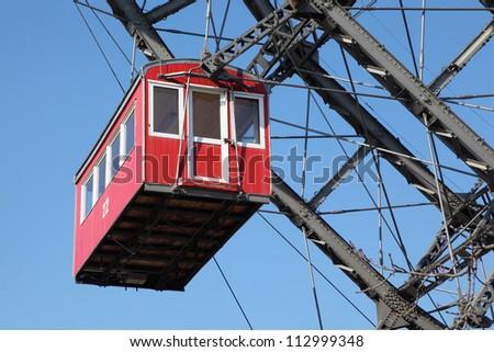 Ferris wheel with red cabine, Prater park in Vienna, Austria, closeup - stock photo