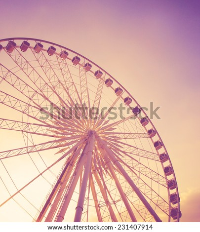 Ferris wheel with summer sky with retro filter effect - stock photo