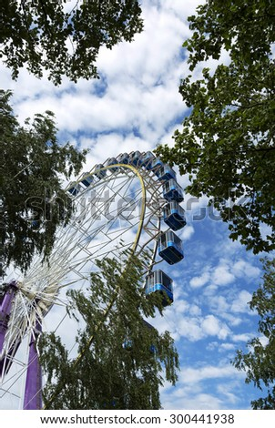 Ferris Wheel with trees in Siofok at Lake Balaton, Hungary - stock photo