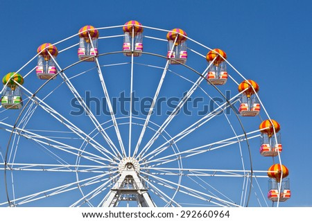 Ferris wheels and blue sky in the background - stock photo