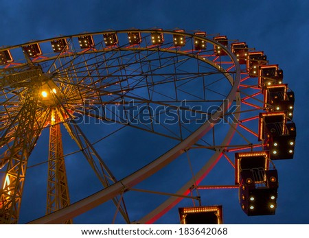 Ferris whiil of illuminatedl in city park. - stock photo