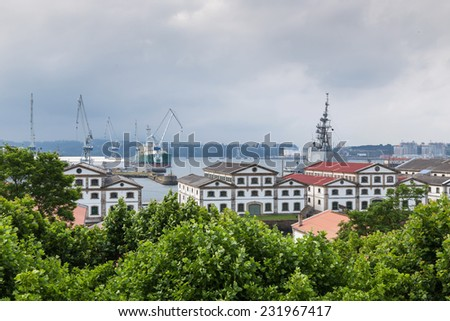 Ferrol estuary with several naval vessels and fishing boats in the harbor, Galicia, Spain