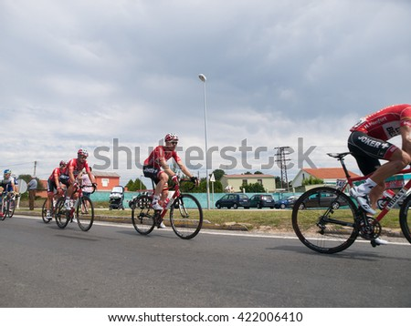 FERROL, SPAIN - SEPTEMBER 10: Unknown racers on the competition Tour of Spain (La Vuelta) on September 10, 2014 in Ferrol, Spain. The photo shows cyclists in a row - stock photo