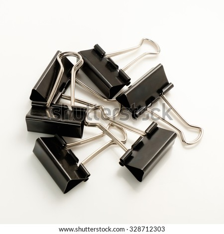 Ferrous metal clips for office works on a white background.