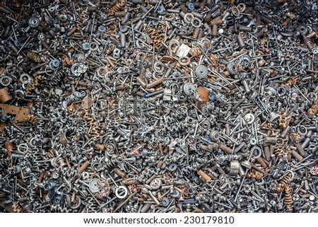 ferrous scrap and mechanisms of various sizes seen from above. - stock photo