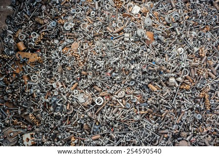 Ferrous scrap and mechanisms of various sizes seen from above. Metal waste - stock photo