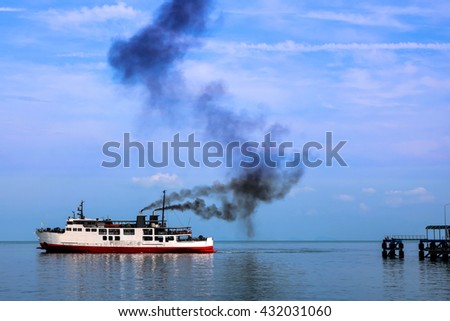 Ferry and the smoke from the engine.